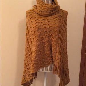Woman's knitted poncho